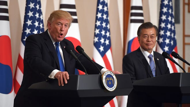 U.S. President Donald Trump, left, speaks as South Korean President Moon Jae-In listens during a joint press conference at the presidential Blue House in Seoul, South Korea, Tuesday, Nov. 7, 2017.