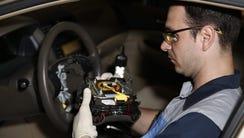 Erland Zeka removes a Takata brand air bag inflators