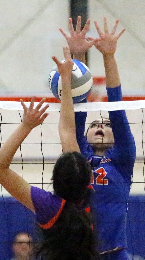 Arzetta Hodges, 12, of Canutillo blocks a shot against