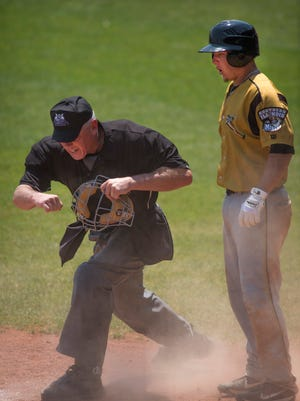 Southern Illinois' Chris Fornaci (10) is called out at home plate by the umpire after trying to score during their game at Bosse Field Wednesday afternoon.