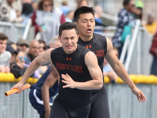 Wesley Weingord takes the baton from team mate Jacob