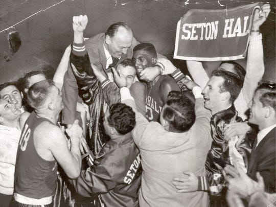 After Seton Hall won the 1953 NIT final over St. John's, head coach Honey Russell embraced Walter Dukes.