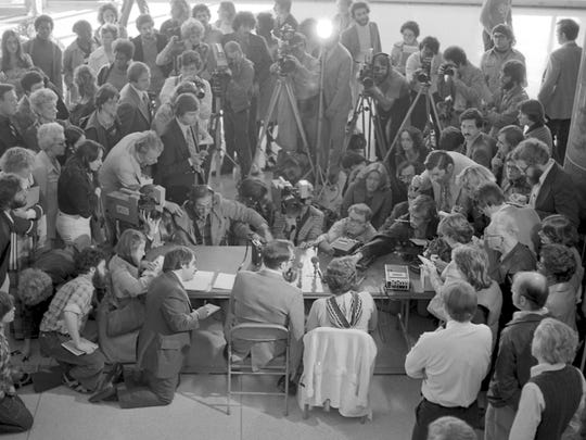 Francine Hughes (seated at right) and her attorney, Arjen Greydanus, address the media after she was found not guilty by reason of temporary insanity in November 1977. She had been charged with murder in the death of her abusive husband.