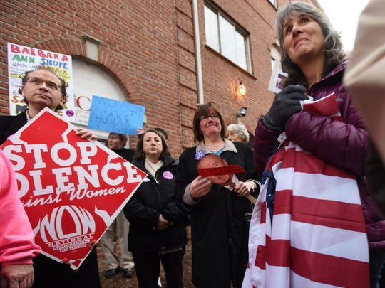 Protesters at Rep. Rodney Frelinghuysen's office in Morristown rally against the Republicanss plan to repeal the Affordable Care Act and defund Planned Parenthood.