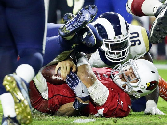 Cardinals quarterback Blaine Gabbert is sacked by Rams
