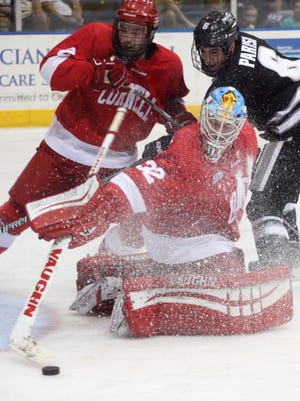 Cornell goalie Mitch Gillam makes a save during a game against Providence while competing in the Florida College Hockey Classic at Germain Arena.