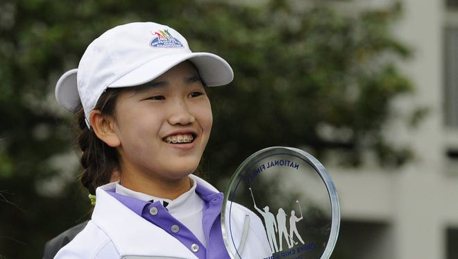 Girls 10-11 category champion Lucy Li from Redwood City, California poses with her trophy during the National Finals of the 2014 Drive, Chip and Putt Championships  April 6, 2014 at Augusta National Golf Club Augusta, Georgia.