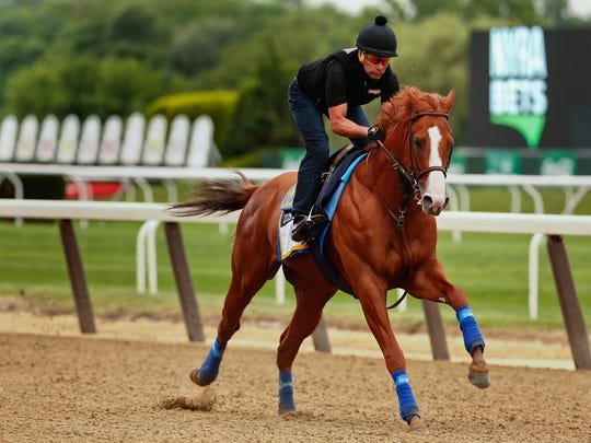 Triple Crown hopeful Justify gallops around the track during a workout at Belmont Park, Thursday, June 7, 2018, in Elmont, N.Y. Justify will attempt to become the 13th Triple Crown winner when he races in the 150th running of the Belmont Stakes horse race on Saturday. (AP Photo/Peter Morgan)