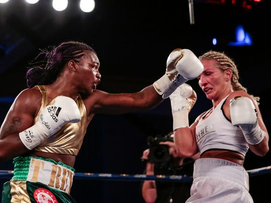 Nikki Adler, right, dodges a punch from Claressa Shields