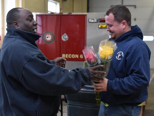 The Vineland fire department are selling over 1500 dozen varierty of roses at Station #6 for  Valentine's Day weekend.   Customer Ron Shinn (right) of Deerfield bought 2 dozen of roses for his girlfriend.   Vineland Firefighter Chris Williams assisted him.  Feb. 11, 2016