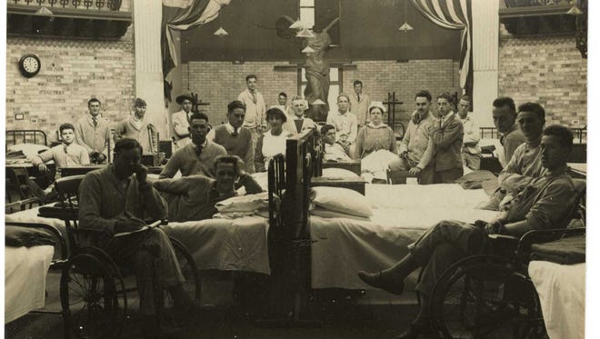 Hazel Lee Weller (nurse on the right side of the picture) with some of her patients at the American Red Cross Hospital, No. 21, Paignton S. Devon.