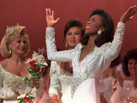 With Miss America 1989 Gretchen Carlson, left, and first runner up Virginia Cha, Miss Maryland, center at her side, Miss America 1990 Debbye Turner of Missouri throws her arms up in the air after winning the title in Atlantic City, N.J. Sept.16, 1989.