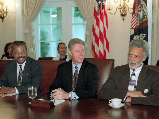 The late Rep. Ron Dellums, D-Calif., right, met with President Clinton and other members of the Congressional Black Caucus June 20, 1996, in the Cabinet Room of the White House.