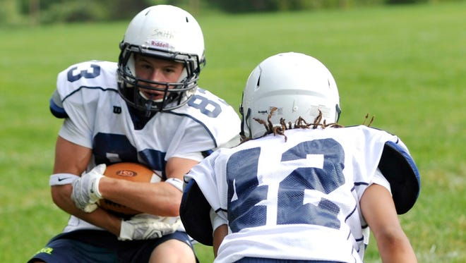 Hunter Smith, left, and Asheville School will host their first-ever night football game on Friday.