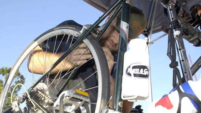Bike mechanic Mark West, 24, of West Des Moines works on a bike in Ames during RAGBRAI in 2008.