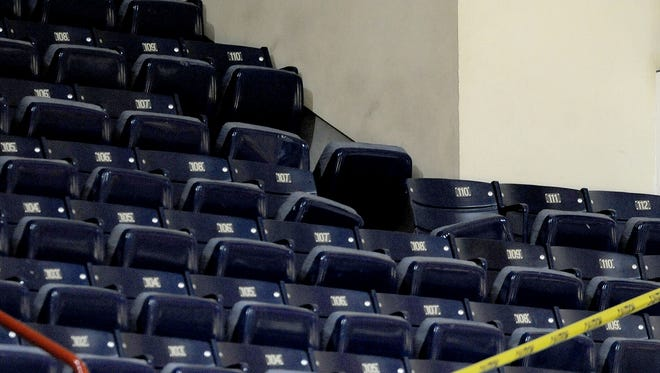 Section F is roped off after a piece of metal facing fell from the ceiling of Assembly Hall in Bloomington, Ind., on Feb. 18, 2014.