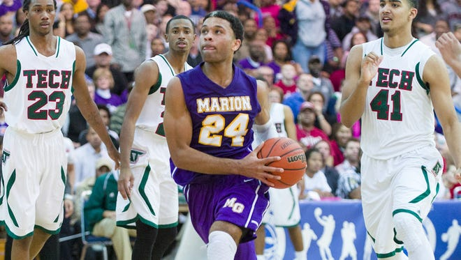 Marion High School senior James Blackmon Jr. (24) drives the ball to the basket after slipping through the Arsenal Tech defense during the first half of varsity basketball action in a game of Indiana's Best Showcase at Marshall High School Dec. 23, 2013.