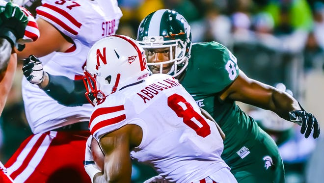 MSU's Shilique Calhoun (89) goes to tackle Nebraska's Ameer Abdullah during Saturday's first quarter in East Lansing.