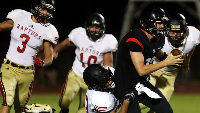 Stewarts Creek quarterback Mason Hall, right, is sacked by Ravenwood's Bryan McKay during the second quarter Friday. Ravenwood scored 56 unanswered points and won 56-14.
