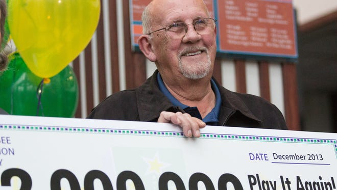 Lottery winner Charles William Whitson smiles about a $2 million mock check on Friday Dec. 20, 2013, in Nashville, Tenn.