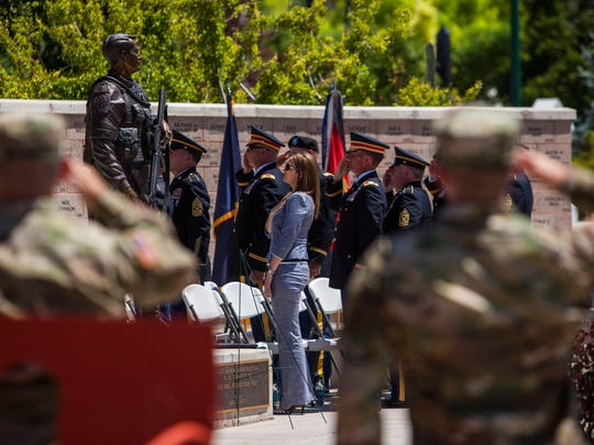 People stand for the National Anthem during the Triple Deuce  Wreath Laying Ceremony at Veterans Memorial Park in Cedar City, Saturday, June 25, 2016.