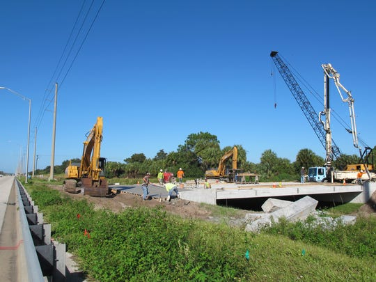The bridge under construction over the Cocohatchee Canal on the north side of Immokalee Road, left, will be the sole access to a two-story charter school planned on Golden Gate Estates property just east of TwinEagles Golf & Country Club.