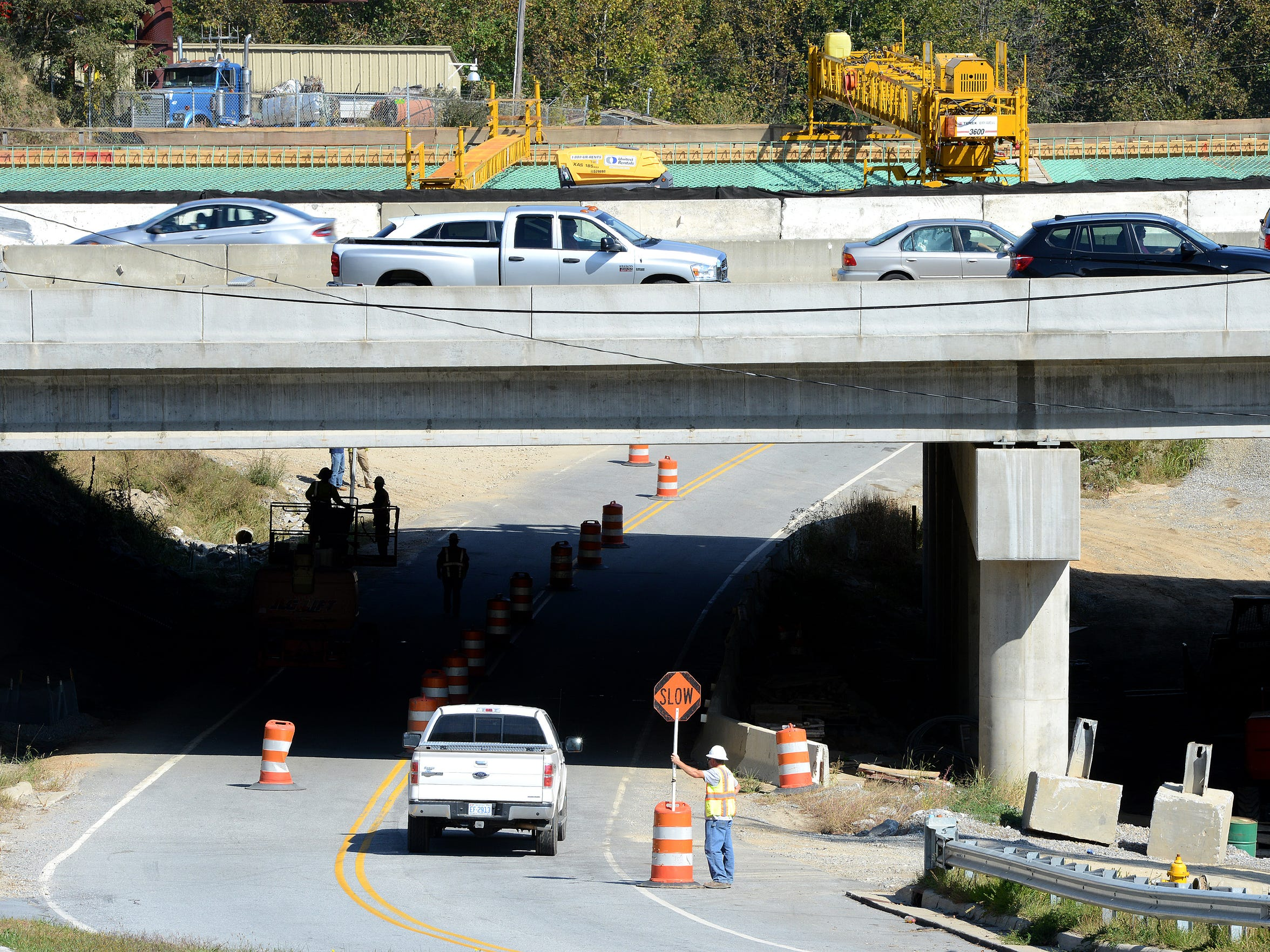 A crew works on a section of I-26 that runs over Pond Road on Oct. 13.