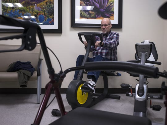 James Martz rides an exercise bike on Jan. 10, 2018,