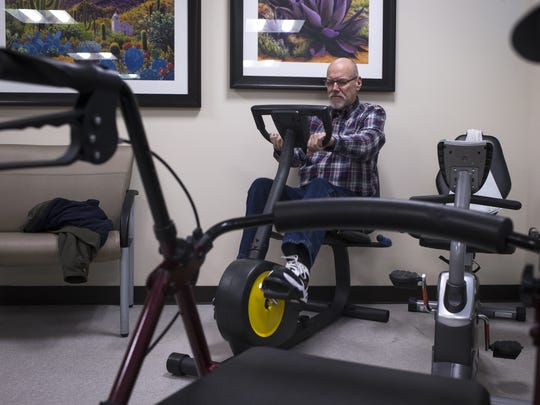 James Martz rides an exercise bike on Jan. 10, 2018, at Circle the City in Phoenix.