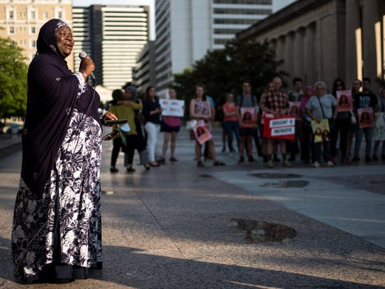Zulfat Suara speaks during a rally organized by the