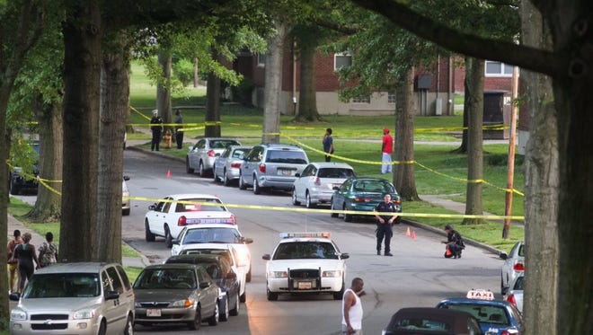 Police investigate a shooting in Roselawn Friday night. The victim was shot in the neck and is expected to survive.