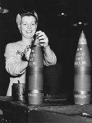 A woman assembles shells at the Cornhusker Ordnance Plant in Grand Island, Nebraska during World War II.