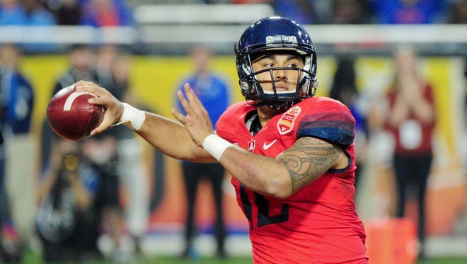 Dec 31, 2014: Arizona Wildcats quarterback Anu Solomon (12) looks to pass during the second half against the Boise State Broncos in the 2014 Fiesta Bowl at Phoenix Stadium.