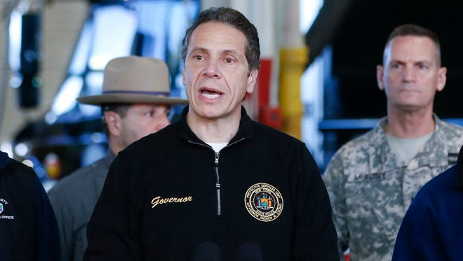 Gov. Andrew Cuomo on Nov. 21 gives a storm update in Cheektowaga after lake-effect snowstorms covered western New York. Cuomo has criticized the National Weather Service for its forecasts of the storm, and said the state is creating its own weather monitoring system.
