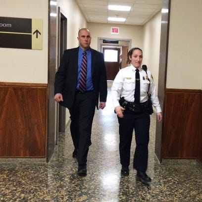 Rochester police officer Michael DiPaola enters court