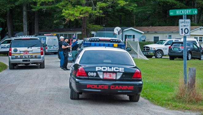 Police assemble at Woodland Shores in Colchester on September 20 in response to reports of gunshots.