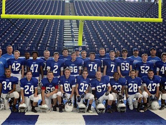 The 2013 Memorial cub football team poses for a photo