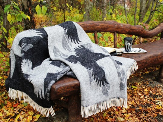 A raven covers this wool blanket from Sveinbjorg.is.