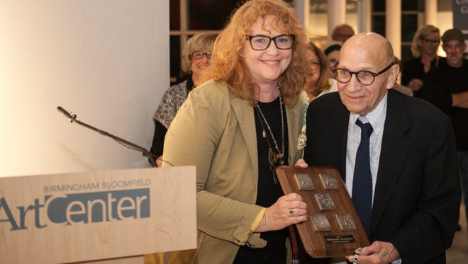At the Cultural Arts award ceremony Laurie Tennent presented Glen Michaels with the plaque designed by Link Wachler. Michael's works are found throughout the United States.