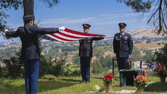 An honor guard took part in the funeral of a family member of columnist Tom Johnson in Atascadero, Calif.