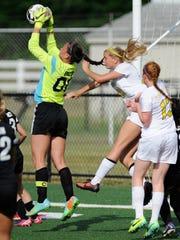 Sussex Tech's goalie #00 Leslie Fazio saves the ball