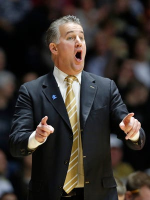 Head coach Matt Painter shouts instructions to his players as they run their offense against Northwestern Tuesday, February 16, 2016, at Mackey Arena. Purdue defeated Northwestern 71-61.