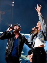 Cole Swindell performs with Lauren Alaina at Nissan