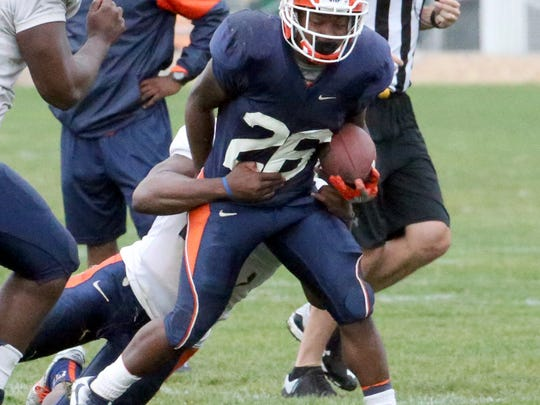 UTEP running back Walter Dawn carries the ball during