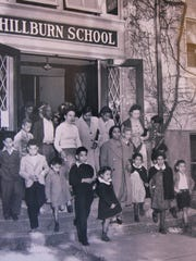 This 1943 photograph shows parents and children of