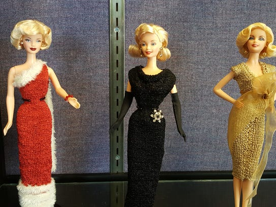 Three Marilyn Monroe Barbie dolls can be seen as part