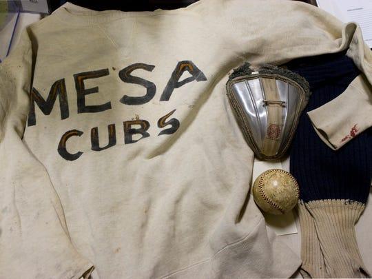 An old Mesa Cubs uniform,  protective cup and baseball