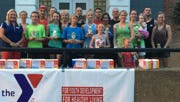 Group picture of the UC YMCA CORN FESTIVAL 5K Run/Walk.
