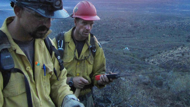 Sunset on June 28, when the Granite Mountain Hotshots worked on a fire outside of Prescott, in an image from Christopher MacKenzie's camera. Their assignment at Yarnell was still two days away.