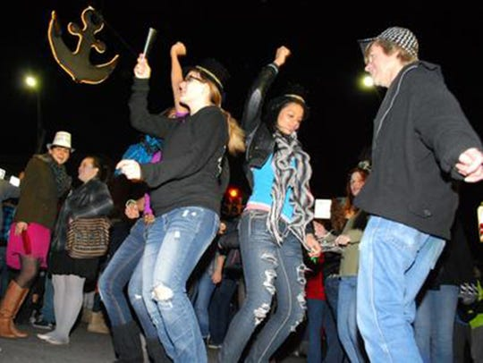 Revelers rock under the anchor at a prior New Year's